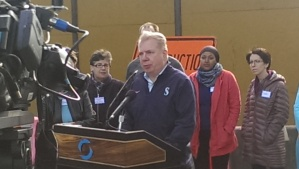 "The Mayor addressing the crowd at ""Find It, Fix It"""